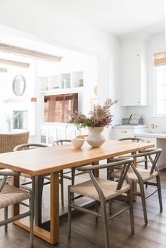Calabasas kitchen remodel. Mixed woods in kitchen design. Kitchen dining area. White walls, white kitchen, wood accents. | Studio McGee Blog