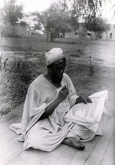 Africa | Embroiderer in Niger. ca. 1928/1930 | Photographer unknown