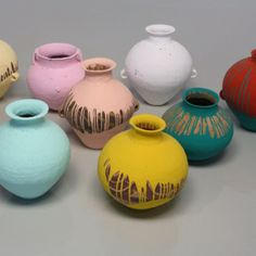 Ai Weiwei - Coloured Vases (2006). Neolithic vases dipped in industrial paint.