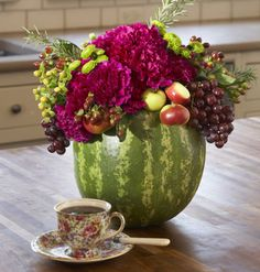 centerpiece of watermelon, grapes, mums and purple carnations....<3