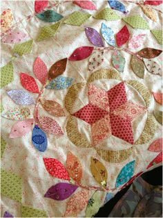 """""""Laurel's Stars"""" designed by Lynne Alchin, as made by someone called Desley, seen on the blog """"Snippets 'n' Scraps"""".  I love all the colours of the leaves."""