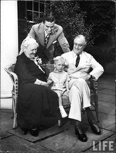 Sara Delano Roosevelt sitting with her son, President Franklin D. Roosevelt, and his son, Franklin D. Roosevelt, Jr. (standing) and grandson, Franklin D. Roosevelt III.