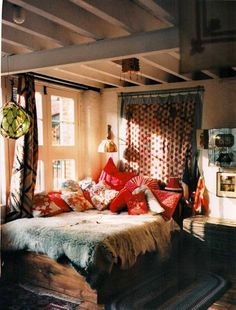 I love the idea of hanging drapes as a headboard...I might just implement that idea