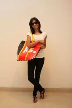 Sadhana Vikrantha from Cinnamon Grand Colombo's Sales Department modelling a B2b (Banners to Bag) bag.