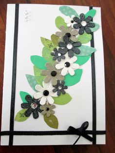 A hand made card with flower stickers