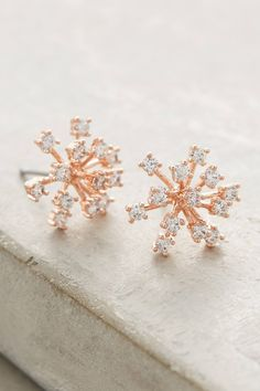 When the weather outside is frightful, brighten things up indoors with adorable snowflake studs on your ears.