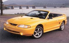 1998 Mustang Cobra SVT convertible, what my daddy has but in blue.... I like the blue better. Grew up with this car and it's still one of my favorites.