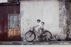 Poetic Street Art by Ernest Zacharevic  Young Lithuanian street-artist Ernest Zacharevic imagines poetic artworks in which he integrate façade elements and plays with perspectives. Creations are linked with childhood. He ornamented façades of Lisbon Atlanta New York Hawaii or Penang.            #xemtvhay