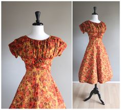 Lovely Abstract Floral 1950s Vintage Day Dress / 1960s / Orange Brown Mustard / Fit & Flare Full Skirt Classic / Rockabilly VLV New Look by TheMermaidTattoo on Etsy https://www.etsy.com/listing/217706458/lovely-abstract-floral-1950s-vintage-day