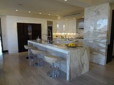 Beautiful Kitchen with Paonazzo Marble Countertops and Silver Tusk Marble Flooring!