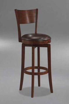 The Archer, available in a brown Finish, is a 360 degree swivel barstool with a dark brown faux leather seat, a transitional arched back design and simple, tapered and slightly flared legs. Composed of hardwoods and climate controlled wood composites, minor assembly required. Finish: Brown Finish