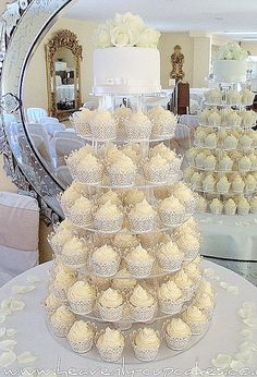 Perfect idea for my wedding! Small cake on top my me and my guy, and cupcakes for everyone else! :)