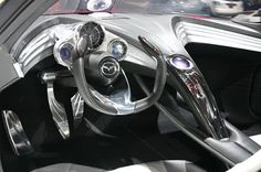The steering wheel is an open top style, which utilizes steer-by-wire technology.