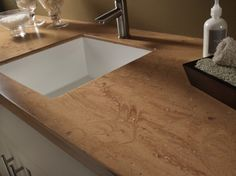 Corian counterstops, sometimes referred to as solid surface countertops, have a number of distinct advantages over ceramic tile or laminate countertops. Solid Surface Countertops, Cheap Countertops, Formica Countertops, Inside Kitchen Cabinets, Buy Kitchen, Kitchen Ideas, Kitchen Design, Kitchen Sink, Wooden Counter