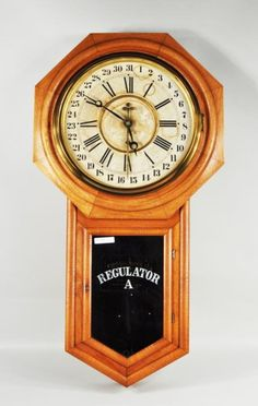 "Ansonia ""Regulator A"" oak cased wall clock, c. 1900, label in interior Ansonia Clock Co, NY, USA."