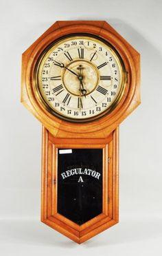 """Ansonia """"Regulator A"""" oak cased wall clock, c. 1900, label in interior Ansonia Clock Co, NY, USA."""