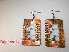 Playing with copper and beads Daphnofila earrings