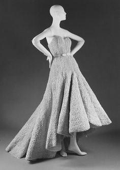 """""""Scarlatti"""" Design House: House of Dior (French, founded 1947) Designer: Christian Dior (French, Granville 1905–1957 Montecatini) Date: spring/summer 1950 Culture: French Medium: (a, b) cotton, silk (c) leather Dimensions: (a) Length at CF: 15 in. (38.1 cm) (b) Length at CB: 53 in. (134.6 cm) (c) Length: 28 1/2 in. (72.4 cm)"""