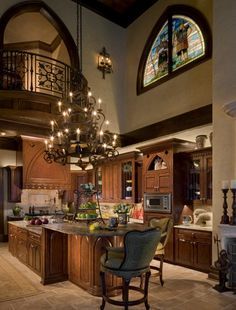 Luxurious Kitchen Chandelier Idea with Brown Granite Countertop Design and Cream Wall Paint Color and Cool Brown Cabinet Set also Cream Ceramic Floor Tiles also Stylish Sink Near Faucet