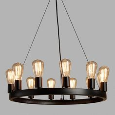 SHOP NOW: Crafted of iron with an industrial-style black finish, our exclusive round chandelier fills a room with the rustic warmth of 12 Edison lights. All 12 lights are included with the chandelier for a brilliant value. Edison Bulb Chandelier, Edison Lampe, Round Chandelier, Industrial Chandelier, Edison Lighting, Industrial Lighting, Chandelier Lighting, Industrial Style, Edison Bulbs