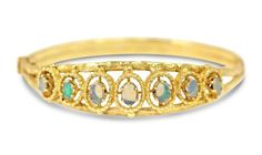"""<b>14kt Yellow Gold and Opal Lady's Bangle Bracelet, Pendant and Earrings, 4 Pcs</b> <br /> Includes one yellow gold bangle bracelet set with a graduated arrangement of approx. 7 oval opals.  Measuring approx. Dia. 2 1/4"""".  Stamped """"14K"""".  Bangle bracelet weighing approx. 23.10 grams.  Includes a yellow gold pendant and neck chain set with a single oval opal.  Measuring approx. L. 16"""".  Stamped """"14K"""".  Pendant and neck chain weighing approx. 2.10 grams total.  Includes a set of yellow gold…"""
