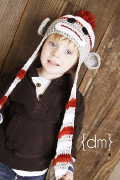 i adore this hat...and this photo..Benson Sock Monkey Hat Extra Long Tassels by meganbmalone on Etsy, $35.00