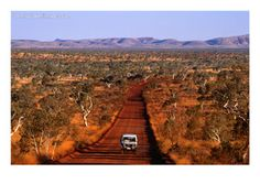 Yep, quite an accurate depiction of the outback.  Not for the faint hearted :).  Car on Outback Road, Karijini National Park, Australia
