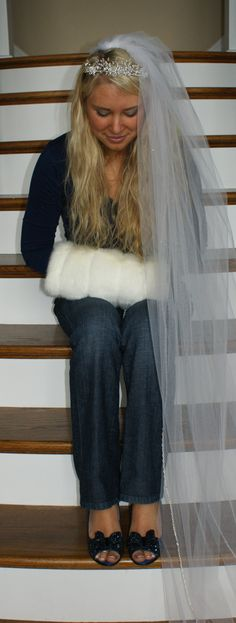 Ashton wearing her wedding shoes, veil and fur muff she wore for her Winter Wonderland Wedding