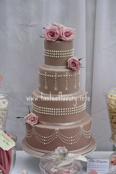 The Elegance cake  A four tiered nude pink cake with hand piping and fresh pale pink roses