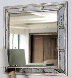 Antique glass panels are skillfully placed to create our Alexa Mirror. The mirror reflects the light and will quickly become the focal point of any room in your home.