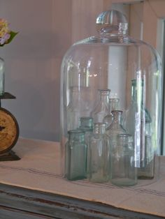 Chateau Chic--smaller apothecary bottles under a large cloche
