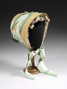 Bonnet, straw trimmed with lace, tulle, silk ribbon and silk flowers, c. 1860, English.
