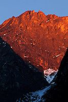 Sunlight at sunset hitting a craggy mountain along the Langtang Valley, Nepal