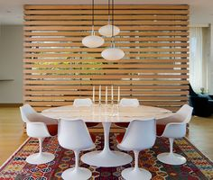 This wooden slat wall partitions off the dining area and gives it a nice…