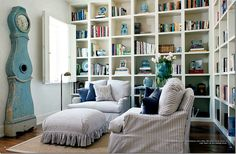 Love the white bookshelves & ticking covered chairs