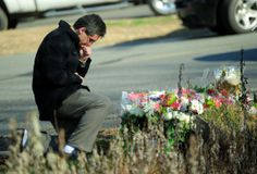 A resident pays tribute to the victims of an elementary school shooting in Newtown, Connecticut, on December 15, 2012