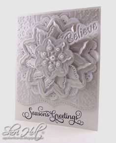 White On White Season's Greetins Christmas card  using Spellbinders Ocean Dreams M-Bossabilities folder, Spellbinders A2 Bracket Borders One die,  Spellbinders Fascination Cut Fold Tuck, Spellbinders Sentiments die & JustRite Large Fancy Holiday Sentiments clear stamps by Sheri Holt
