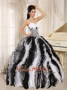 White and Black Ruffles Quinceanera Dress With Appliques Sweetheart For Custom Made In Honolulu City Hawaii  http://www.fashionos.com    The pretty zebra quinceaera dress features a sweetheart neckline and a two-toned puffy skirt. The gorgeous skirt is made from many scraps of various white and black scraps and also lines of small tulle flowers, which add to its beauty, fullness and lovely shape. The lace up back finish the look.