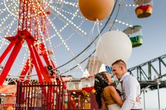 Bride and Groom at Sydney's Luna Park, with giant balloons