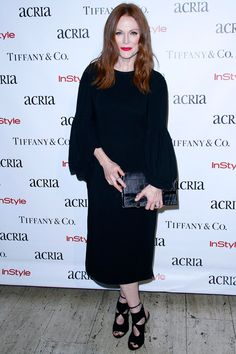 Julianne Moore opted for a dramatic bell-sleeved dress for ACRIA's 20th Anniversary Holiday Dinner on December 10, 2015