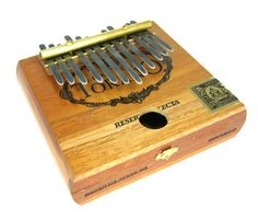 Beautiful handmade instrument from Etsy- Cigar box thumb piano!