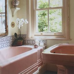 Pink bathroom suite with blue & white tiles from @houseandgardenuk March 16. Don't ditch your avocado basin just yet.