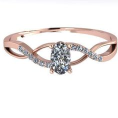 Perfect for Valentine's day! 14K Rose Gold Oval Infinity Band with  Diamonds. A perfect gift for a loved one! This ring could be a Mother's Ring or even a special present for anyone in your life. The center stone, which is a oval cut, and the metal can both be personalized to your liking.