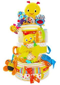 $119.99-$191.00 Baby Busy Bugs Baby Shower Diaper Cake for Infant Boys or Girls - These bugs are busy welcoming a new baby into the world. This bright and fun three tier diaper cake is sure to be the hit of the shower! Colorful receiving blankets, Johnson & Johnson's  baby products and fun toys for baby make this cake a gift to remember. This gift comes wrapped with matching ribbons and includes ...