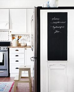 Spruce Up Eyesores To disguise the black side of the refrigerator, Chris created a makeshift wall using an antique door adorned with decorative molding and chalkboard paint. Rustic Kitchen, New Kitchen, Kitchen Decor, Kitchen Ideas, Copper Kitchen, Kitchen Living, Country Kitchen, Small Storage, Storage Place
