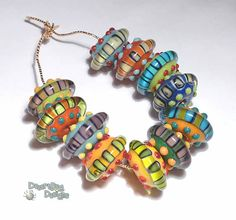 SAUCER SIGHTING Lampwork Beads Handmade Bright Color Mix Red Blue Green Yellow Purple   Set of 11