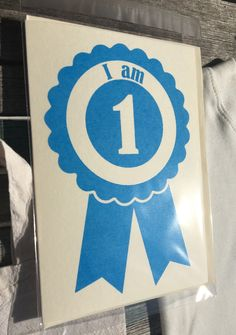 One of a kind screen printed rosette card for a First Birthdayavailable in… Handmade Baby Gifts, New Baby Gifts, Congratulations Gift, Organic Baby Clothes, Newborn Baby Gifts, Chicago Cubs Logo, First Birthdays, Baby Shower Gifts, Screen Printing
