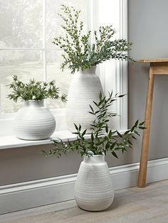 Beautifully handmade from earthenware with a soft geometric textured finish, our whitewash vases have a weighty rounded base and an open top with ample room for flowers. Choose from three sizes to suit your living space.