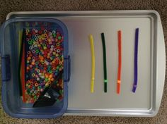 Preschool bead tray--good work task as long as the child isn't in danger of swallowing small beads.  You could adapt it with larger beads.