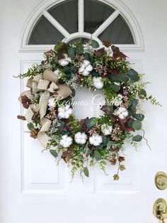 Eucalyptus, burgundy variegated ivy, garden ferns and dusty miller create a beautifully textured display to add to your farmhouse decor. Cotton bolls, cream pip berries and clusters of dusty pink star flowers create a unique look to add to your home decor. A double bow of natural canvas